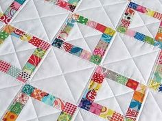 OOh. I finally found a quilt idea I like for using up the fabric form baby blankets!