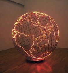"""In London and Berlin-based Palestinian artist Mona Hatoum's sculptural work titled """"Hot Spot"""", we are presented with a massive cage-like metallic globe radiating a crimson glow. In terms of global pol (Diy Photo Lighting)"""