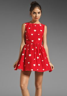 this dress is adorably chic! and SO me! white heart print on red dress