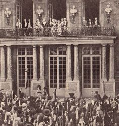 Louis XVI, Marie Antoinette and the rest of the French royal family on the balcony of Versailles during the October Days.  From the silent film L'enfant Roi (1923)