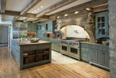 green kitchen cabinets with beamed ceilings