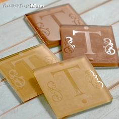 DIY Etched Monogram Glass Tile Coasters Tutorial using Silhouette Cameo - from Architecture of a Mom