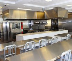 Culinary Learning: The renovations of the Free Library of Philadelphia, Parkway Central Branch included the construction of a demonstration kitchen to provide culinary literacy classes to children, teens, families, and adults. It includes three ovens, a grill top, 16 burners, a walk-in fridge, nine tables, cameras that provide views of the prep space and the burners with feeds to a big flatscreen TV, and an outdoor patio with an herb garden. Renovation; Safdie Architects; Photo: Eileen…