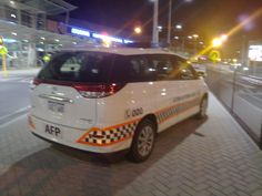 https://flic.kr/p/8Dho9B | Australian Federal Police Marked Toyota Tarago | Seen outside Perth International Airport.  Sorry for the blurred shot
