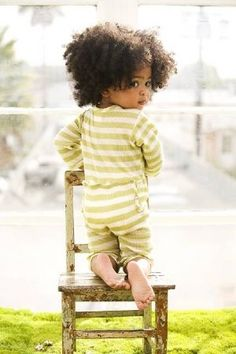 Check out the big fro on the little girl, delish!