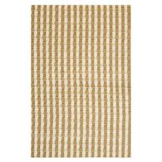 Handmade jute rug with a striped weave.   Product: RugConstruction Material: JuteColor: Tan and whiteFeatures:  Handmade in IndiaBack has an anti-slip coating0.38 Pile height  Note: Please be aware that actual colors may vary from those shown on your screen. Accent rugs may also not show the entire pattern that the corresponding area rugs have.