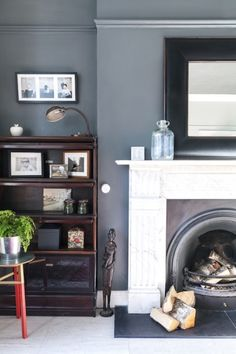 The living room's white fireplace was originally in the dining room. A favourite with collectors, the modular shelving is an original barrister bookcase, circa 1930, from the Globe-Wernicke Company.