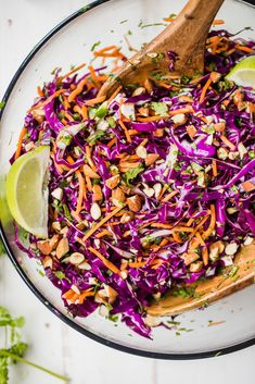 The BEST healthy coleslaw made with fresh purple cabbage carrots cilantro and a kick of heat from jalapeño. There's no mayo just a naturally sweet and slightly tangy dressing. This simple healthy coleslaw is perfect serving with your favorite grillin Clean Eating Recipes For Dinner, Clean Eating Breakfast, Clean Eating Meal Plan, Salad Recipes For Dinner, Clean Eating Snacks, Healthy Coleslaw Recipes, Vegan Coleslaw, No Mayo Coleslaw, Paleo Recipes