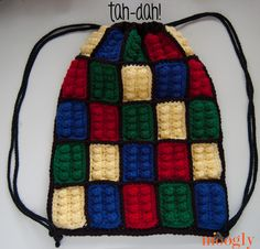 Crochet Handbags Lego Inspired Crochet Backpack - free pattern on moogly! More - The Lego Inspired Crochet Backpack is a simple pouch with a set of drawstrings that close up the top and double as the straps! Get the free pattern today! Crochet Lego, All Free Crochet, Crochet Gifts, Crochet For Kids, Crochet Dinosaur, Crochet Handbags, Crochet Purses, Purse Patterns, Crochet Patterns