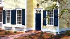 Window shutters vinyl dark blue shutters on yellow house with white trim Cottage Shutters, Window Shutters Exterior, Rustic Shutters, House Shutters, House Siding, Navy Shutters, Yellow House Exterior, Exterior Paint Colors For House, Paint Colors For Home