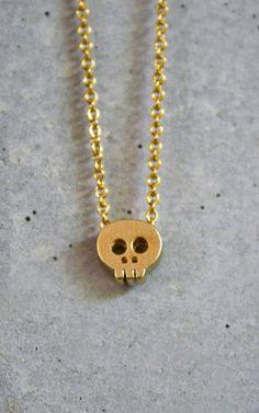 tiny gold skull necklace. delicately feminine