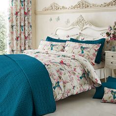 Featuring colourful exotic birds on a soft floral and butterfly pattern base in shades of coral and teal with piped edges, this printed duvet cover set will instantly brighten up your bedroom