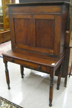 "A Victorian drop-front table desk, American southern plantation, mid 19th century, having a recessed drop-front, lift-top top section on table base with drawer and round/octagonal turned legs. Dimensions: 58.25""H x 36.5""W x 20.75""D."