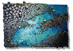 Connecticut-based artist Amy Eisenfeld Genser (previously) recently completed a new series of coral reefs that she painstakingly recreates using rolled bits of paper and acrylic paint. Ahead of her upcoming exhibition at the Architectural Digest Home Show, Genser sat down with All Th
