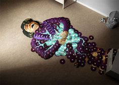 """""""Can't stand you're love"""" - Artists Mirco Pagano and Moreno De Turco spent more than 200 hours lining up the CDs to achieve a realistic look. What's incredible is that they used not just some random colorful CDs, but musicians' own albums!"""