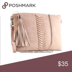 Tassel Clutch Solid Stitch Tassel and wrist strap clutch with metal strap. H 6.0 L 11.0 W 1.25. PU faux leather. 1 compartment and 1 zipper pocket. 1 small pouch. Zipper closure Bags Clutches & Wristlets