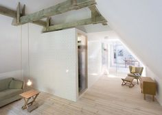 Hayloft in a thatched farmhouse in Föhr, Germany, converted into an apartment with spotty tiles by Francesco Di Gregorio and Karin Matz.