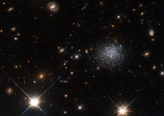 The fuzzy collection of stars seen in this Hubble Space Telescope image forms…