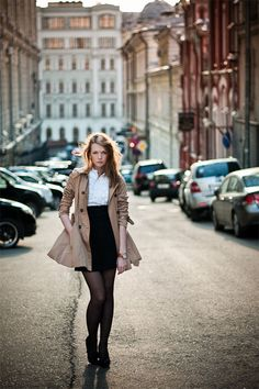 Pencil skirt + tights + a romantic ruffled blouse + a perfect trench with the sleeves pushed back