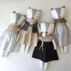 Luckyjuju dolls are handmade from mostly new, but sometimes vintage or upcycled fabrics, yarn, and 100% wool felt. The face has hand drawn and hand embroidered elements. They are made to be played with and loved by gentle children over 3. This kitten comes with a lovely dress with an