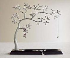 Display and store your jewelry with this elegant sculpted jewelry holding tree. There are many branches in this tree that let you be creative in how you...