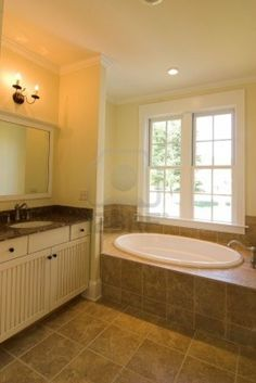 dark tan tile bathroom - This wall color could work with the existing tan tile