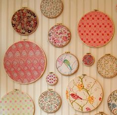 We like this idea for using up your leftover fabric scraps. Use a variety of different sizes of wood embroidery hoops and place a different fabric in each one. Then use the fabric covered hoops to decorate an entire wall in the office or craft room.