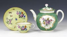 A Worcester teapot and cover and a teacup and saucer circa 1770, later decoration