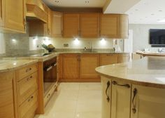 Professionally Installed Bespoke luxury Kitchen from Dobsons using the Stoneham Srata Oak & Alabaster painted furniture, dressed with Ivory Fantasy granite worktops, Miele appliances and LED feature lighting