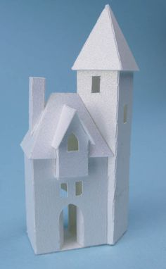 Tiny Old Town is a set of 8 miniature paper buildings. There are three color choices available for this kit, white, black and gingerbread...