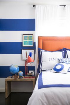 Striped royal-blue walls contribute a playful touch to a young boy's room | domino.com