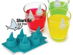 Keep drinks cold with shark fin ice cubes. Toss them into glasses or larger punch-filled fish bowls.