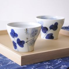 Tea cups with blue floral design.