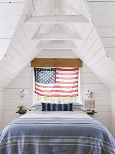 An American flag hangs above the bed in the master bedroom.