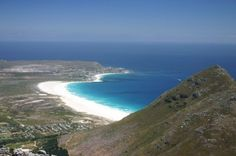 Noordhoek in Cape Town, South Africa, is a picturesque sandy beach! South Africa Beach, Cape Town South Africa, Beautiful Places To Visit, Places To See, Beautiful Landscape Pictures, See World, Surf City, White Sand Beach, Surfing