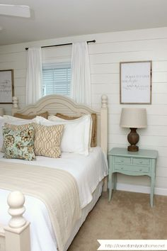 Farmhouse house master bedroom makeover with shiplap walls.