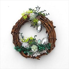 Its twinkly, like a holiday. A one of a kind custom Christmas wreath for your dollhouse decorating. Pretty greens mixed with silver and sparkles with a