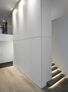 HS Residence by CUBYC architects I like the wall of storage and the lighted stairs Interior Stairs, Interior Architecture, Contemporary Interior Design, Modern Interior, Stair Lighting, Basement Stairs, Ground Floor Plan, Minimalism, Interior Decorating