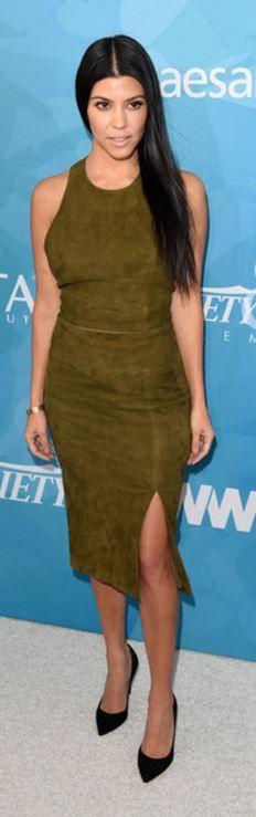 Kourtney Kardashian: Shirt and skirt – Alice + Olivia  Bracelet – Cartier
