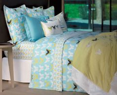 Butterfly-themed bed linens against turquoise. So pretty and chic, great for a spring bed. Envol Luxury Bedding Collection by Yves Delorme.