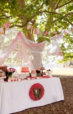 Table decor included pink, pink, pink with a splash of red & just a hint of forest green. We used pink and white tulle, some with metallic threads, green velvets and toadstool prints. What fairy frolicking in the woods could resist this trap?