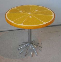 Orange slice table from CarlChaffee.com. I can't quite tell what it's made of, but appear to be translucent. So midcentury/pop.
