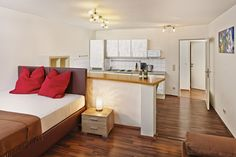 The generous space in this apartment provides lots of room for unforgettable moments with your loved ones. This holiday apartment contains 1 bedroom with a double bed, a living roo Holiday Apartments, Double Beds, Vienna, Corner Desk, Bedroom, City, Table, House, Furniture