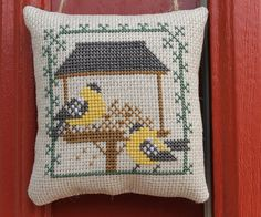 Completed Cross Stitch Gold Finches on a Bird by Stitchcrafts