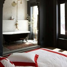 Interesting. Minimalist bedroom with small bathtub right there in the room. I rather like it.