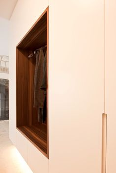 INTERIOR-iD Cloakroom suspended from ceiling with concealed lights underneath. Niche with hanging rail made in American walnut and integrated with staircase Wardrobe Closet, Built In Wardrobe, Walk In Closet, Entry Stairs, Joinery Details, Hanging Rail, American Walnut, Wardrobe Design, Closet Organization