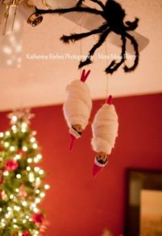 Do this with the kids toys such as the Barbie doll and Superman doll wrapped up by the spider!