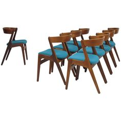 Eight Danish Curved Back Dining Chairs  | From a unique collection of antique and modern dining room chairs at https://www.1stdibs.com/furniture/seating/dining-room-chairs/
