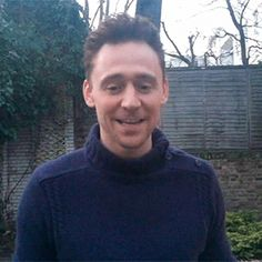 Hiddles laugh. Also I've never seen him in a turtleneck before.