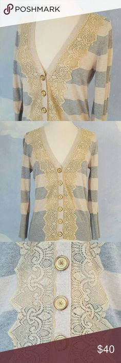 """Anthropologie Charlotte Cardigan Golden cream lace and vintage gold buttons give this classic striped sweater a romantic look.  Measures 22"""" shoulder to hem; 16"""" across bust when layed flat. Size is listed as Large but it fits snuggly. More like a small/ medium. Please read measurements before purchasing. Anthropologie Sweaters Cardigans"""